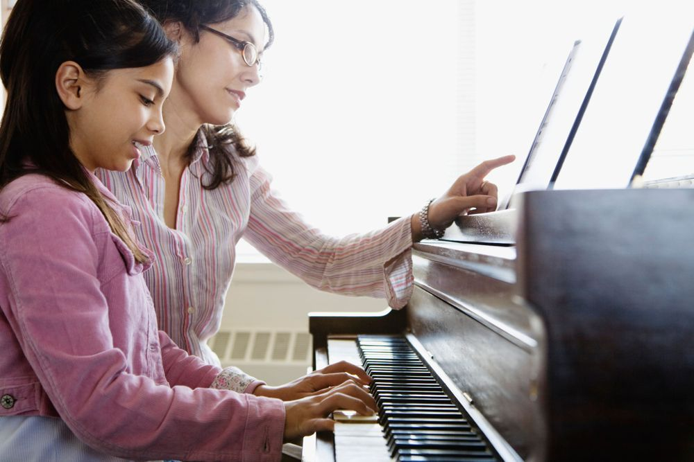 Penn Square Music Conservatory teaching child to play piano